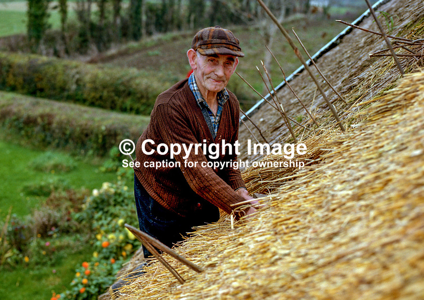 Thatcher working on the roof of Andy and Lily Freeburn's cottage near Ballintra, Co Donegal, Rep of Ireland. 197810000319L..Copyright Image from Victor Patterson, 54 Dorchester Park, Belfast, UK, BT9 6RJ..Tel: +44 28 9066 1296.Mob: +44 7802 353836.Voicemail +44 20 8816 7153.Skype: victorpattersonbelfast.Email: victorpatterson@mac.com.Email: victorpatterson@ireland.com (back-up)..IMPORTANT: If you wish to use this image or any other of my images please go to www.victorpatterson.com and click on the Terms & Conditions. Then contact me by email or phone with the reference number(s) of the image(s) concerned.