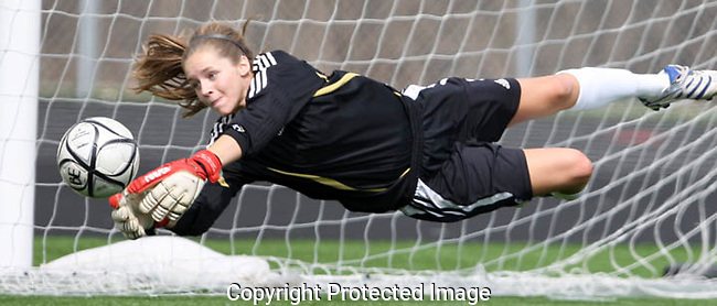 Goalie Lauren Gunderson goes parallel as she makes a stop during a Middleton High School soccer game.