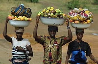 Women carrying various fruit to the market