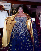 """Singer Aretha Franklin shows off her dress to photographers as she attends the 1999 White House Correspondents Association Dinner at the Washington Hilton Hotel in Washington, D.C. on May 1, 1999.  Ms. Franklin later performed her song """"R-E-S-P-E-C-T""""..Credit: Ron Sachs / CNP"""