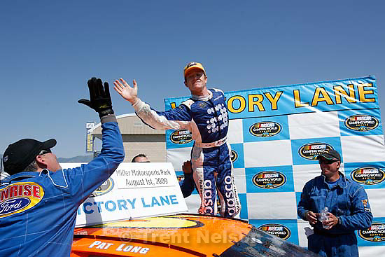 Tooele - Patrick Long, driver for AASCO Motorsports celebrates with team members after he took first place at the Nascar Camping World Series Saturday, August 1 at Miller Motorsports Park..