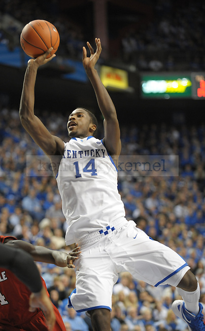 Kentucky's Michael Kidd-Gilchrist (14) puts up a shot during the first half of the University of Kentucky Basketball game against Louisville at Rupp Arena in Lexington, Ky., on 12/31/11. Michael Kidd-Gilchrist  scored a career high 24 points and 19 rebounds. UK won the game 69-62. Photo by Mike Weaver | Staff