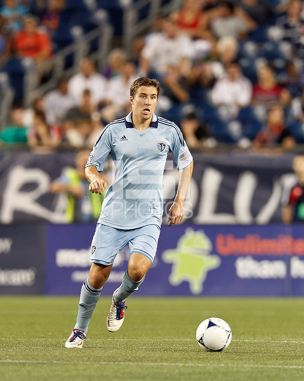 Sporting Kansas City defender Matt Besler (5) brings the ball forward. In a Major League Soccer (MLS) match, Sporting Kansas City defeated the New England Revolution, 1-0, at Gillette Stadium on August 4, 2012.