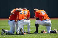 Virginia Cavaliers pregame prayer before Game 11 of the NCAA College World Series against the Florida Gators on June 19, 2015 at TD Ameritrade Park in Omaha, Nebraska. The Gators defeated Virginia 10-5. (Andrew Woolley/Four Seam Images)