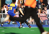 NZ's Simon Childs takes on Nabil Fiqri Mohamad Nor during the international hockey match between the New Zealand Black Sticks and Malaysia at Fitzherbert Park, Palmerston North, New Zealand on Sunday, 9 August 2009. Photo: Dave Lintott / lintottphoto.co.nz