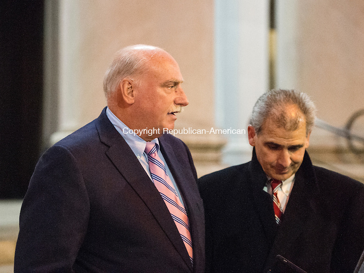 NEW HAVEN, CT- 13 January 2015-011316EC05-    Peter Clark (L) walks out of the federal courthouse in New Haven Wednesday with his attorney, William Stevens. Clark was sentenced 3 years, 9 months in prison for stealing $1.8 million from a woman who left money to Oxford. Erin Covey Republican-American
