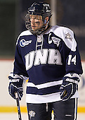 Mike Borisenok (UNH - 14) - The University of Maine Black Bears defeated the University of New Hampshire Wildcats 5-4 in overtime on Saturday, January 7, 2012, at Fenway Park in Boston, Massachusetts.