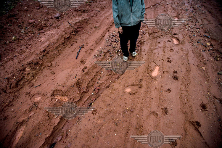 Li Zhiguang standing on a landfill site built on what was once his land in Paitou Village. Land around the village was expropriated by the local government to make way for a new power station planned by the Fuyuan Industrial Group....