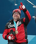 Pyeongchang, Korea, 17/3/2018-- Dennis Thiessen,  competes in the bronze medal game of wheelchair curling during the 2018 Paralympic Games. Photo: Scott Grant/Canadian Paralympic Committee.