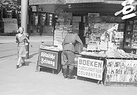 Photo from the NIOD's Huizinga collection. The predominantly German-language offering of periodicals in a newspaper and magazine kiosk taken over by the German occupying forces, The Hague (1940-1945) Menno Huizinga was part of the Hidden Camera and made illegal photos during the occupation. He did this mainly in his hometown The Hague.