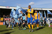 Jason McCarthy of Wycombe Wanderers and Krystian Pearce of Mansfield Town enter the field ahead of the Sky Bet League 2 match between Wycombe Wanderers and Mansfield Town at Adams Park, High Wycombe, England on 25 March 2016. Photo by David Horn.
