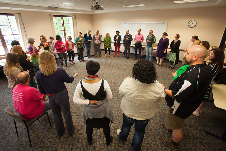 Strands of yarn weaves the circle of particpants together during the Web of Affirmation exercise at the Summer Institute for Diversity Education (SIDE) at Ohio University. The programs is designed to promote cross-cultural understanding and inclusiveness.  Photo by Ohio University / Jonathan Adams
