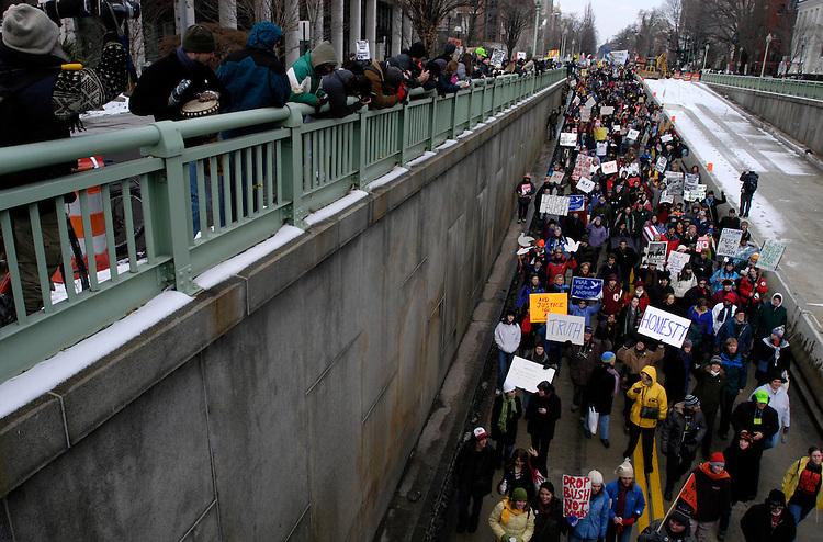A few thousand protesters against the 2005 Presidential Inauguration parade down 16th St. NW.