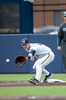 Michigan Wolverines first baseman Jimmy Kerr (15) stretches for a throw to first during the NCAA baseball game against the Michigan State Spartans on May 7, 2019 at Ray Fisher Stadium in Ann Arbor, Michigan. Michigan defeated Michigan State 7-0. (Andrew Woolley/Four Seam Images)