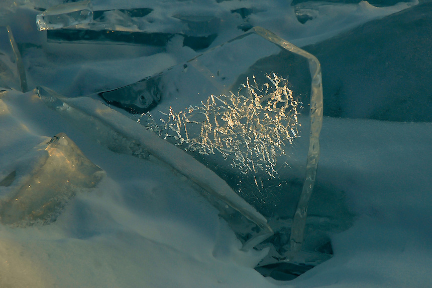Sunlight passing through cracks in an ice plate on Lake Superior,