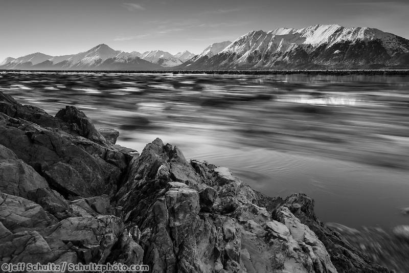 spring landscape of ice moving as tide retreats along Turnagain Arm with Kenai Mountains in Southcentral, Alaska  April 2017<br /> <br /> Photo by Jeff Schultz/SchultzPhoto.com  (C) 2017  ALL RIGHTS RESERVED