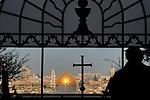 A view of Jerusalem's old city, Israel, with the Dome of the Rock, as seen from within The Sanctuary of the Dominus Flevit on Mount of Olives.<br />