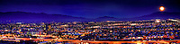 Panoramic view of Tucson and the rising full moon at night, Arizona.