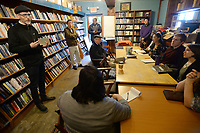 NWA Democrat-Gazette/ANDY SHUPE<br />Jonathan Stalling (left), a poet and professor of English at the University of Oklahoma, speaks Saturday, Oct. 12, 2019, during a poetry workshop at Nightbird Books in Fayetteville that is part of a tour meant to unite U.S. and Chinese poets.