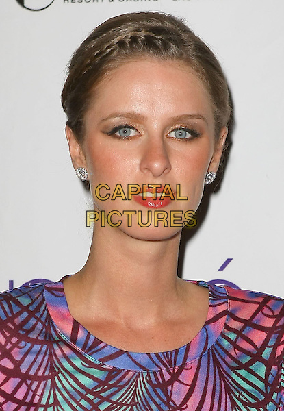 NICKY HILTON.Nicky Hilton hosts a night at Prive' Nightclub at the Planet Hollywood Resort Hotel and Casino, Las Vegas, Nevada, USA..April 11th, 2009.headshot portrait braid plait hair purple blue pink green .CAP/ADM/MJT.© MJT/AdMedia/Capital Pictures.