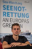 """Pressekonferenz der zivilen Seenotrettungsorganisation Sea-Watch am 2. Juli 2019 in Berlin, nachdem die Kapitaenin des Rettungsschiff """"Sea-Watch 3"""", Carola Rackete, in Italien festgenommen wurde. Die Kapitaenin hatte am 29. Juni gegen den Willen der italienischen Regierung auf der Mittelmeerinsel Lampedusa, mit 40 aus Seenot geretteten Fluechtlingen, im Hafen angelegt und war daraufhin festgenommen worden.<br /> Im Bild: Chris Grodotzki, Medienkoordinator an Bord der Sea Watch-3.<br /> 2.7.2019, Berlin<br /> Copyright: Christian-Ditsch.de<br /> [Inhaltsveraendernde Manipulation des Fotos nur nach ausdruecklicher Genehmigung des Fotografen. Vereinbarungen ueber Abtretung von Persoenlichkeitsrechten/Model Release der abgebildeten Person/Personen liegen nicht vor. NO MODEL RELEASE! Nur fuer Redaktionelle Zwecke. Don't publish without copyright Christian-Ditsch.de, Veroeffentlichung nur mit Fotografennennung, sowie gegen Honorar, MwSt. und Beleg. Konto: I N G - D i B a, IBAN DE58500105175400192269, BIC INGDDEFFXXX, Kontakt: post@christian-ditsch.de<br /> Bei der Bearbeitung der Dateiinformationen darf die Urheberkennzeichnung in den EXIF- und  IPTC-Daten nicht entfernt werden, diese sind in digitalen Medien nach §95c UrhG rechtlich geschuetzt. Der Urhebervermerk wird gemaess §13 UrhG verlangt.]"""