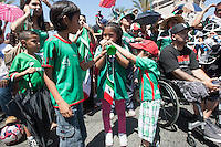 Los Angeles, CA -  Monday, June 23, 2014: A few young Mexico fans are distracted from watching the Mexico vs. Croatia first round match at a public viewing at Plaza Mexico.