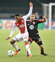 Rodney Wallace (22) of the Portland Timbers goes against Chris Korb (22) of D. C. United. The Portland Timbers defeated D.C. United 2-0, at RFK Stadium, Saturday May 25 , 2013.