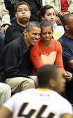 United States President Barack Obama and first lady Michelle Obama attend the Towson State University - Oregon State University basketball game on the campus of Towson State University in Tiwson, Maryland, Saturday, November 26, 2011. The first lady's older brother, Craig Robinson, is the head coach of the Oregon State team..Credit: Martin Simon / Pool via CNP
