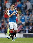 Lee Wallace thumps the Rangers badge on his chest