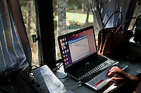 Computer training on ICT bus in Kabaya, Rwanda. (Photo by Tadej Znidarcic)