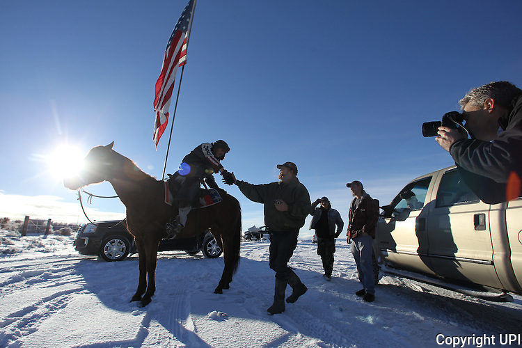 Duane Ehmer, of Irrigon, Oregon, left, greets Brad Williams, who joined the armed activists at the Malheur National Wildlife Reserve on January 15, 2016 in Burns, Oregon. Ehmer has been pulling sentry duty during the takeover. Ammon Bundy and about 20 other protesters took over the refuge on Jan. 2 after a rally to support the imprisoned local ranchers Dwight Hammond Jr., and his son, Steven Hammond.      Photo by Jim Bryant/UPI