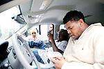 Rapper Wale waits to head to a magazine portrait shoot outside of Magic City, an Atlanta strip club, October 12, 2011.