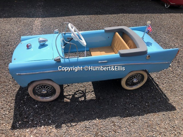 BNPS.co.uk (01202 558833)<br /> Pic: Humbert&Ellis/BNPS<br /> <br /> A Tri-ang aphicar from the 1960's, est. £2.250.<br /> <br /> £200,000 of pedal power...<br /> <br /> A remarkable single owner collection of over 85 vintage toy cars has emerged for sale for £200,000.<br /> <br /> The fleet of rare pedal cars which were acquired over half a century form what is thought to be the biggest private collection of its kind in the world.<br /> <br /> It includes child car models of Rolls Royces, Bugattis and Bentleys, as well as a quirky amphibian car. <br /> <br /> The collection has been consigned for sale with Humbert & Ellis Auctioneers by a retired businessman in his 80s.<br /> <br /> He travelled all over the world to get his hands on the cars, and built a barn next to his Devon home to display them in.