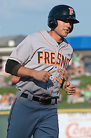Fresno Grizzlies outfielder Roger Kieschnick #39 rounds third base during the Pacific Coast League baseball game against the Round Rock Express on May 19, 2012 at The Dell Diamond in Round Rock, Texas. The Grizzlies defeated the Express 10-4. (Andrew Woolley/Four Seam Images).