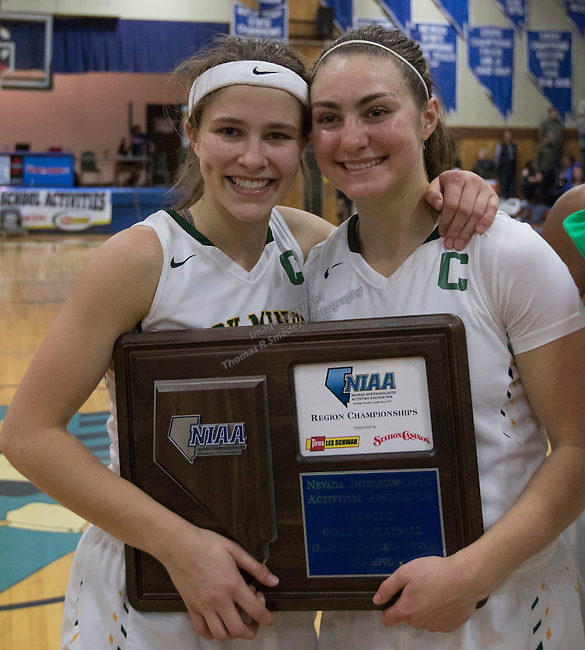Manogue captains Katie Turner and Malia Holt with their Regional Championship Basketball trophy at Carson City High School on Saturday, February 18, 2017.