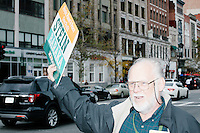 Green Party Boston Ward 11 Chairman Ralph Walton, of Jamaica Plain, holds a Stein campaign sign toward traffic before a campaign rally for Green Party presidential nominee Jill Stein at Old South Church in Boston, Massachusetts, on Sun., Oct. 30, 2016. Walton first worked for a political campaign when Mel King was the Rainbow Party candidate in the 1983 Boston mayoral race.