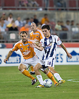 Pachuca FC midfielder Jose Torres (18) and Houston Dynamo mdifielder Brian Mullan (9) battle for control of the ball.  Houston Dynamo defeated Pachuca FC 2-0 in the semifinals of the Superliga 2008 tournament at Robertson Stadium in Houston, TX on July 29, 2008.