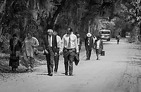 Members of the First Union African Baptist walk from services to the community center in the former Mary Fields school. The church, now a historical landmark, began in 1879 when John Stoddard divided his Mary Field plantation into lots and sold 12 acres to former slaves for the purpose of building a church and cemetery. The original church building burned in 1884 and was rebuilt in 1885.