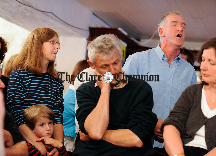 A youngster listens with the crowd as Donie Nolan of West Limerick performs at one of the singing sessions during the Feakle Trad Festival. Photograph by John  Kelly