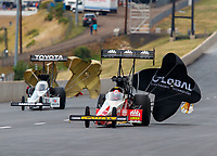 Jul 23, 2017; Morrison, CO, USA; NHRA top fuel driver Doug Kalitta (right) alongside Antron Brown during the Mile High Nationals at Bandimere Speedway. Mandatory Credit: Mark J. Rebilas-USA TODAY Sports
