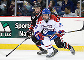 Jamie Oleksiak (Northeastern - 6), Shayne Thompson (Lowell - 23) - The visiting Northeastern University Huskies defeated the University of Massachusetts-Lowell River Hawks 3-2 with 14 seconds remaining in overtime on Friday, February 11, 2011, at Tsongas Arena in Lowelll, Massachusetts.