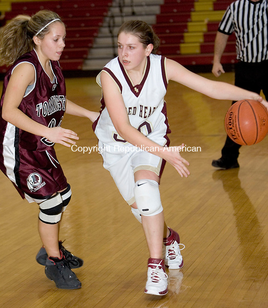 WATERBURY, CT- 15 JAN 2008- 011508JT09-<br /> Sacred Heart's Jennifer Massicotte dribbles past Torrington's Kaylee Cerruto during Tuesday's game at Sacred Heart. Hearts won 58-46.<br /> Josalee Thrift / Republican-American