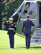 United States President Barack Obama salutes the Marine Guard as he boards Marine One to depart the White House in Washington, D.C. for Henderson, Nevada on Sunday, September 30, 2012..Credit: Ron Sachs / Pool via CNP