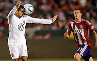 DC United defender Barry Rice heads a ball squarely on his head as  CD Chivas USA forward Justin Braun looks on. CD Chivas USA beat DC United 1-0 at Home Depot Center stadium in Carson, California on Sunday August 29, 2010.