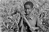 After losing his parents to AIDS, a boy has to live with his grandmother in Kumi, Uganda on April 10, 2001. He says she makes him work in the field all day, every day. More than 13 million African children who have been orphaned by the the AIDS pandemic. Worldwide, more than 20 million people have died since the first cases of AIDS were identified in 1981.