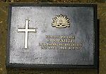 A grave marker of R.A. Smith in a cemetery filled with the graves of nearly 7,000 Australians and Englishmen who died  during World War II in Kanchanaburi, Thailand. Over 16,000 allied P.O.W.s died of starvation, maltreatment and disease while building the bridge on the River Kwai and a 250- mile railway from Thailand into Burma. The Bridge on the River Kwai, known to many P.O.W.'s as the bridge of sorrow, attracts thousands of tourists yearly. (Jim Bryant Photo).....