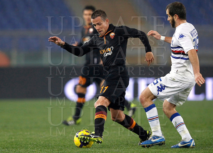 Calcio, ottavi di finale di Coppa Italia Tim: Roma vs Sampdoria. Roma, stadio Olimpico, 9 gennaio 2014.<br /> AS Roma midfielder Rodrigo Taddei, of Brazil, is challenged by Sampdoria midfielder Enzo Maresca during the Italy Cup round of sixteen football match between AS Roma and Sampdoria at Rome's Olympic stadium, 9 January 2014.<br /> UPDATE IMAGES PRESS/Isabella Bonotto