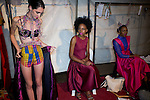 HARARE, ZIMBABWE - SEPTEMBER 26: Models wait backstage before a fashion show with the designers Ingo & Towa on September 26, 2014 at the Harare City library in Harare, Zimbabwe. Local and African and based designers showed their collections during the 5th edition of Zimbabwe Fashion week (Photo by: Per-Anders Pettersson)
