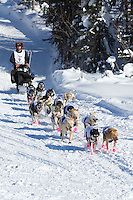 Nicolas Petit on Long Lake at the Re-Start of the 2012 Iditarod Sled Dog Race