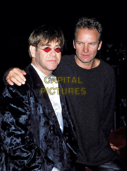ELTON JOHN & STING .Ref: 734 .sunglasses, shades, arm on shoulder, half length, half-length.www.capitalpictures.com.sales@capitalpictures.com.© Capital Pictures